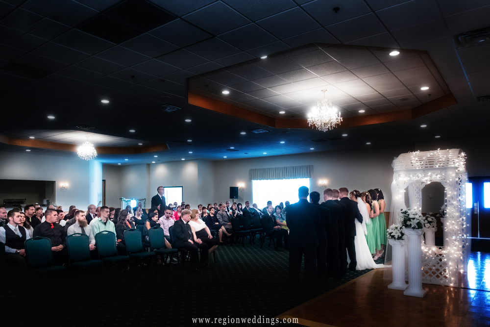 Sun streams in during an indoor wedding ceremony at The Patrician Banquet Hall.