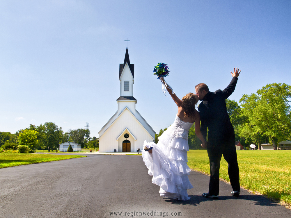 Bride and groom dance toward Grace Lutheran Church in Hobart, Indiana.