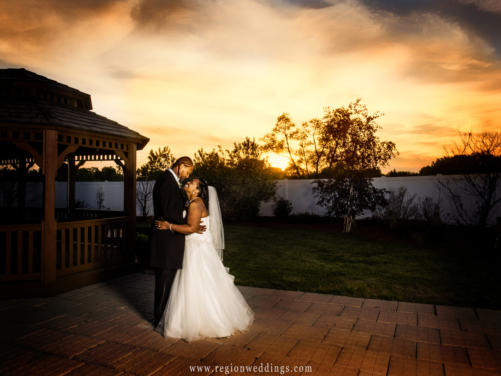 The bride and groom embrace at sunset after their Spring wedding at The Patrician.