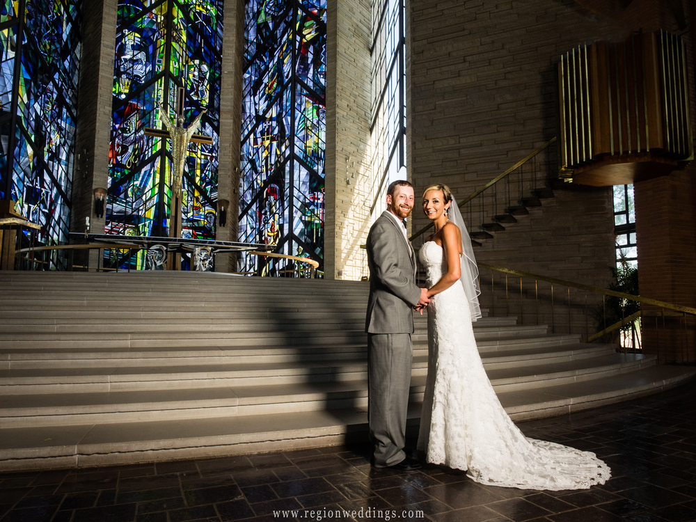 Bride and groom at the steps leading to the altar at The Chapel of Resurrection in Valparaiso University.