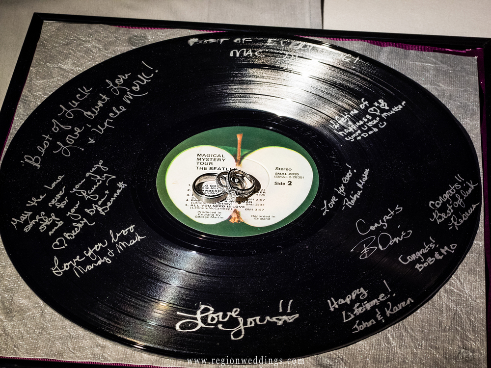 Wedding guests sign the Magical Mystery Tour vinyl album.