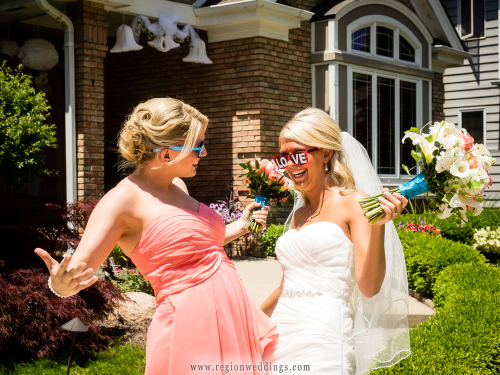 A fun wedding photo between the bride and her maid of honor.