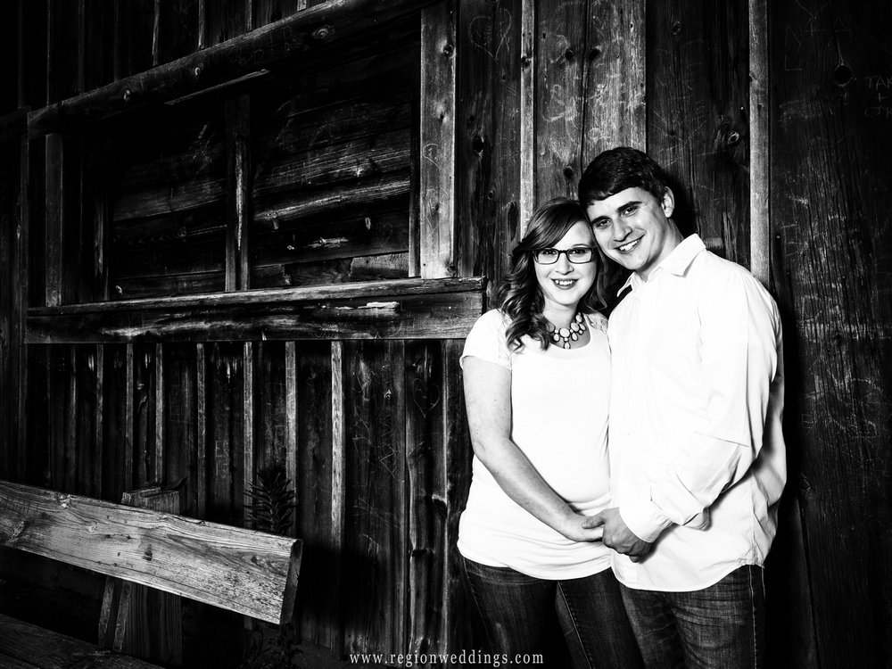 A young couple in front of the Sugar Shack at Deep River County Park.