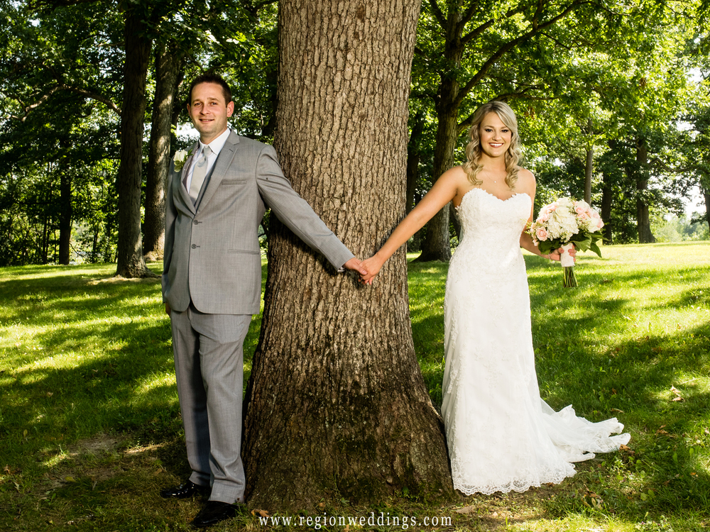 The bride and groom have their first look inside Lemon Lake Park in Crown Point, Indiana.