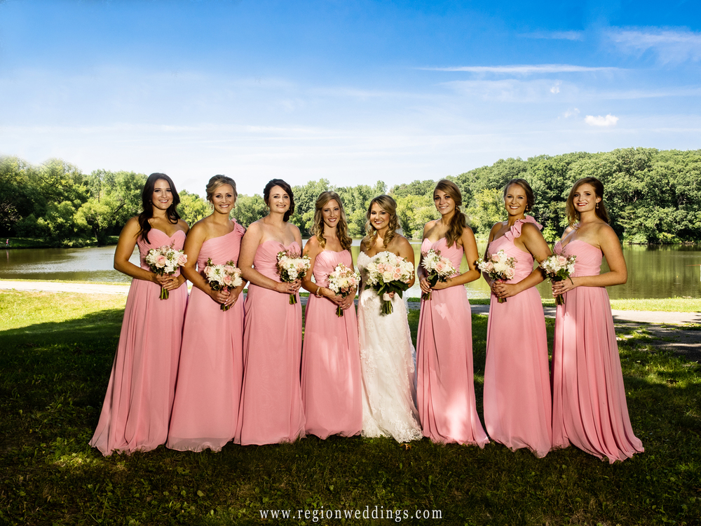 Bridesmaids show off their pretty pink dresses at Lemon Lake Park in Crown Point, Indiana.