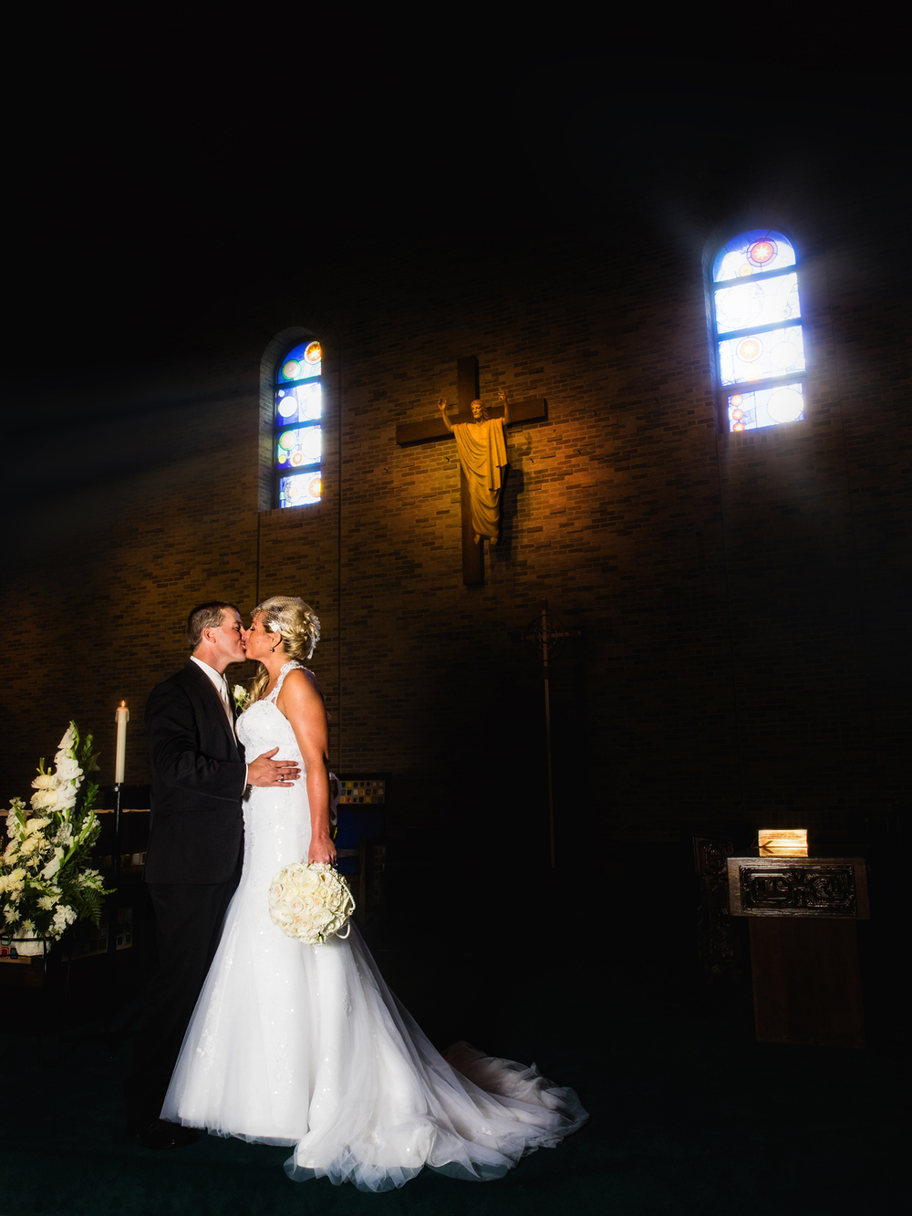 Bride and groom kiss on the altar.