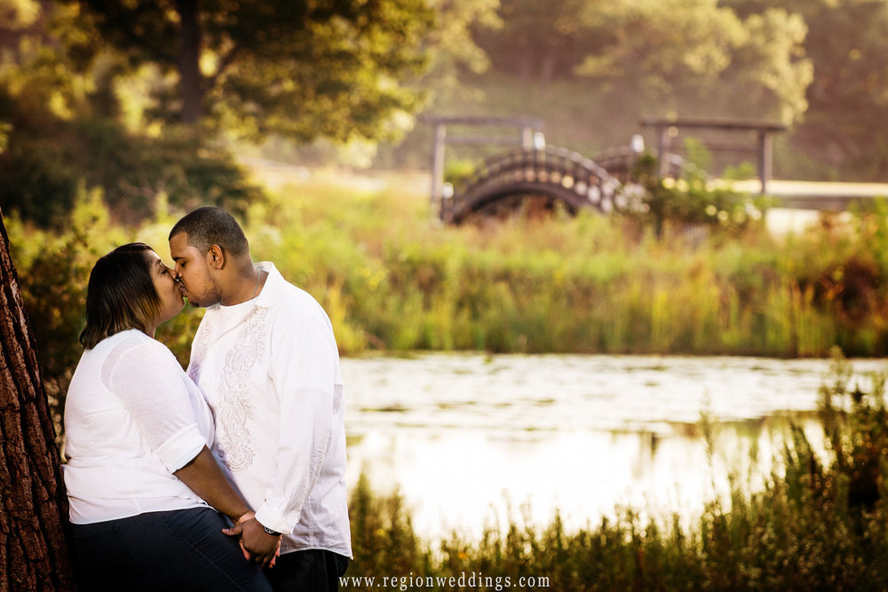 Romantic kiss along the Marquette Park Lagoon