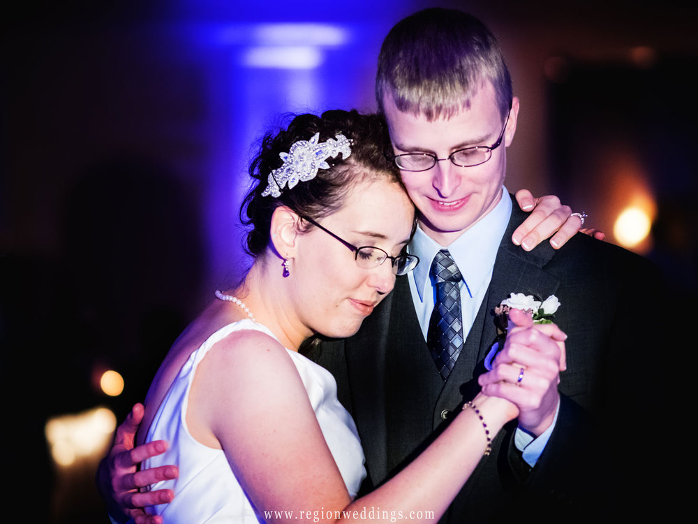 A tender moment on the dance floor for the bride and groom.