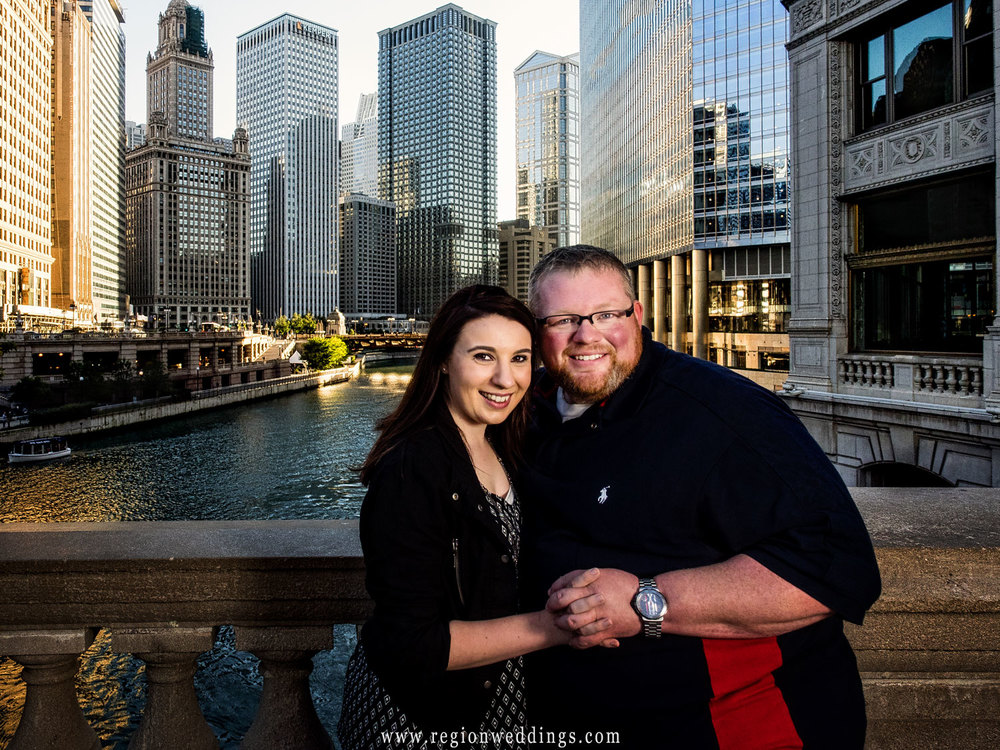 Holding hand with the Chicago River and city skyscrapers in the background.