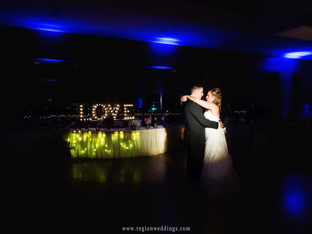 The first dance in front of an illuminated sign of LOVE at Centennial Park.