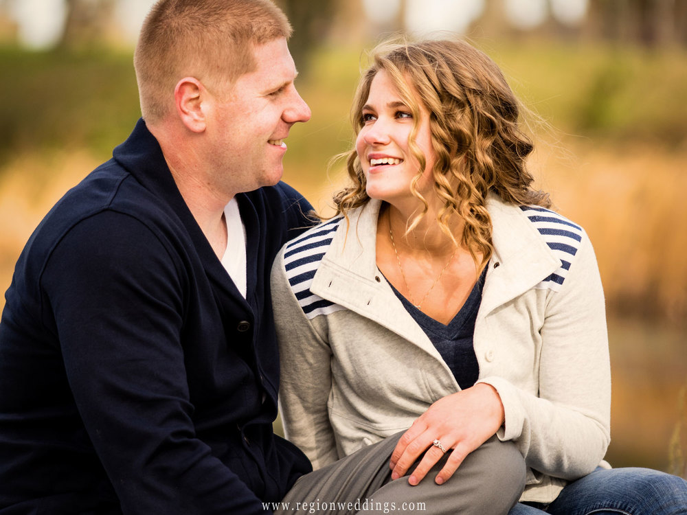 romantic-laugh-beach-engagement-photo.jpg