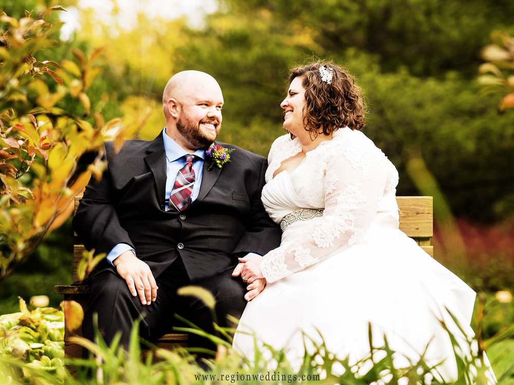 The bride and groom share a moment in the garden at Taltree Arboretum.