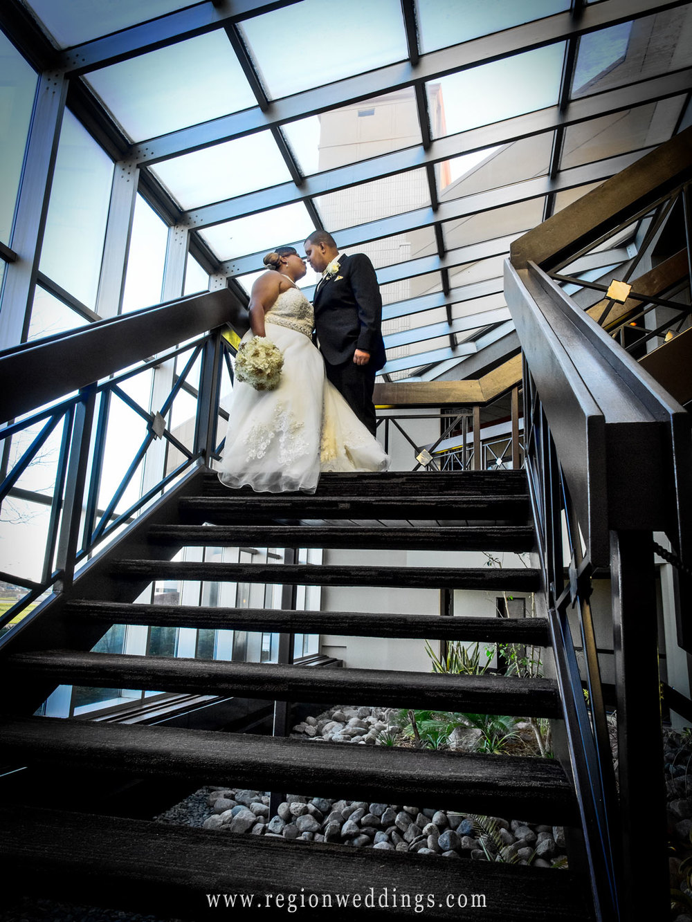 Bride and Groom on the staircase at Radisson at Star Plaza Theater.