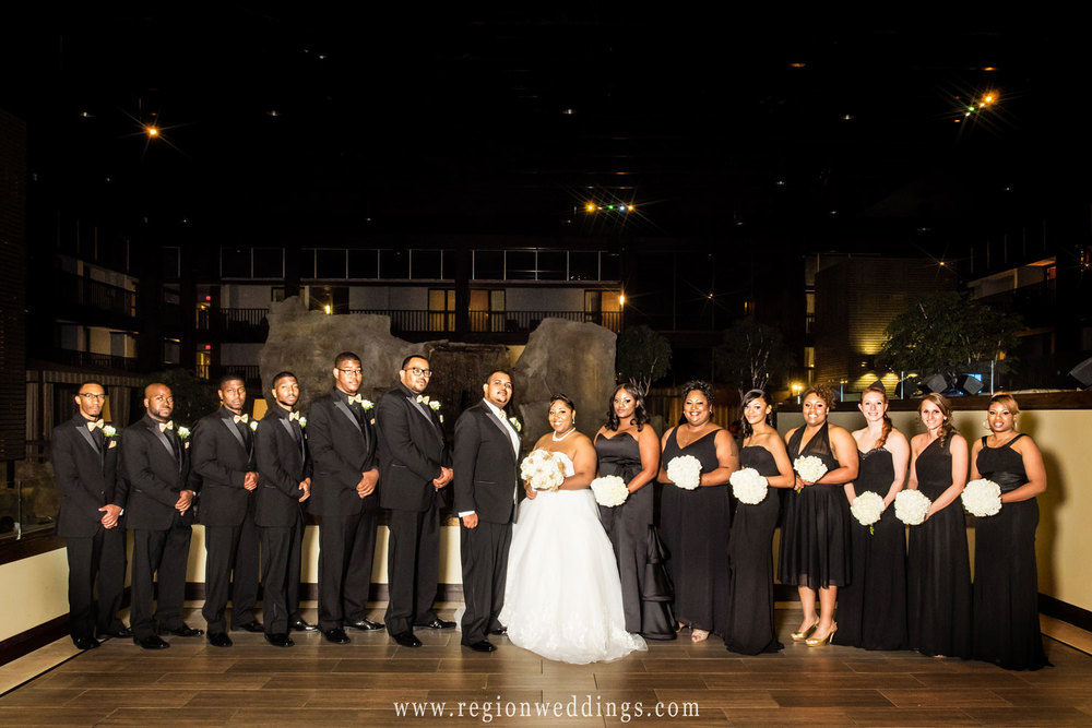 A large wedding party group shot in the front lobby of Radisson Hotel.