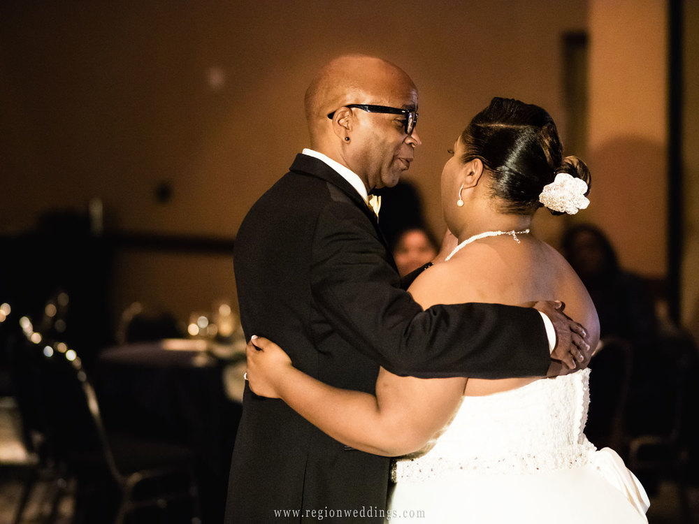 The bride's father dances with her at her wedding at Radisson Hotel.