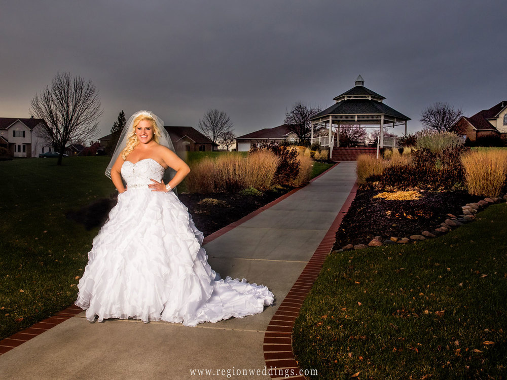The bride in front of the gazebo inside the Ellendale Farms neighborhood in Crown Point, Indiana.