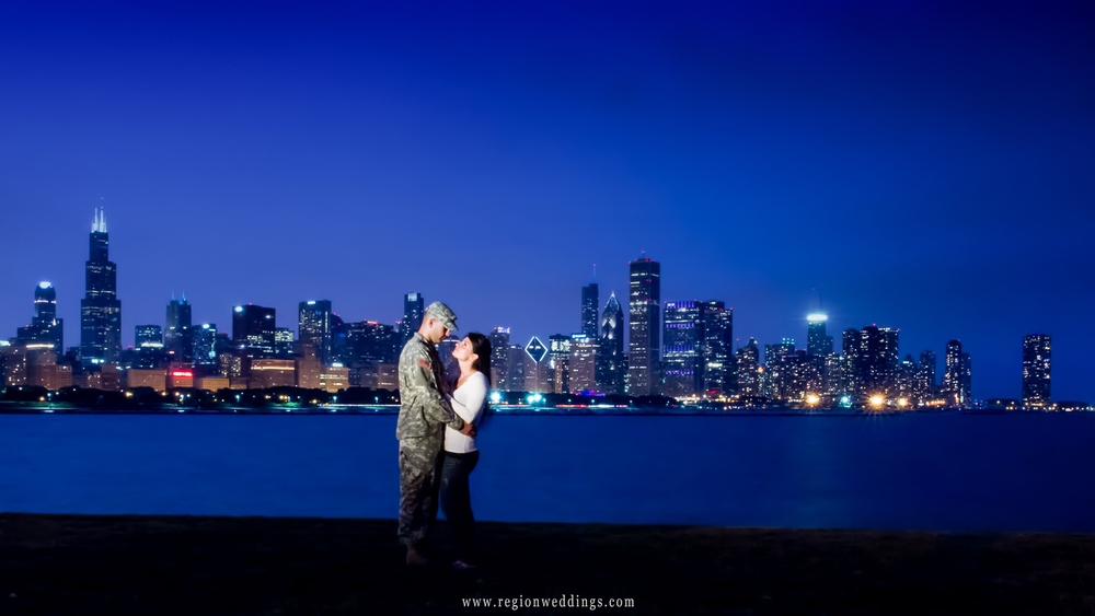 Chicago Session engagement photo at night with the Chicago Skyline in the background.