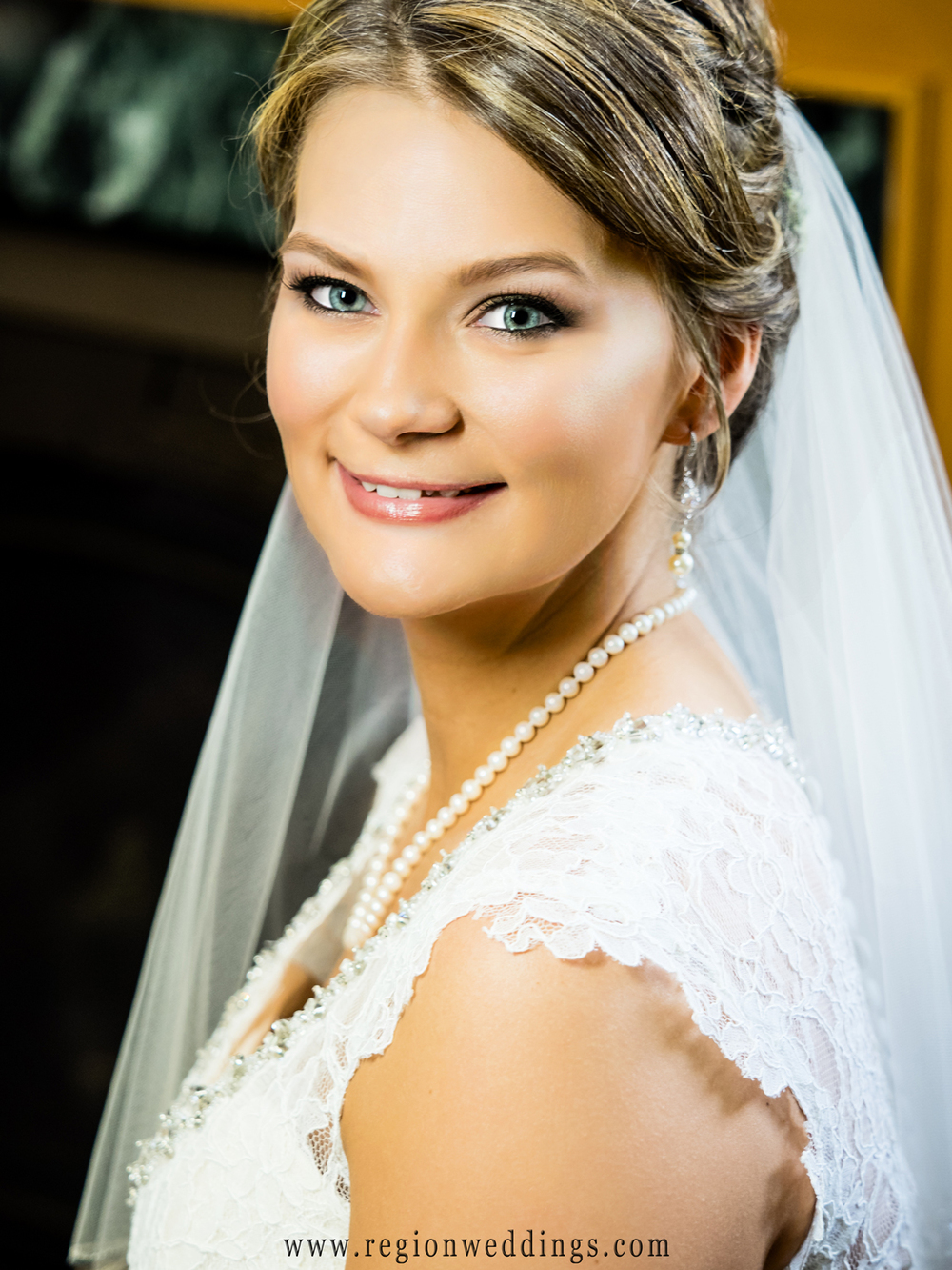 Close up of the beautiful bride before her wedding at Trinity Hall in Chesterton, Indiana.