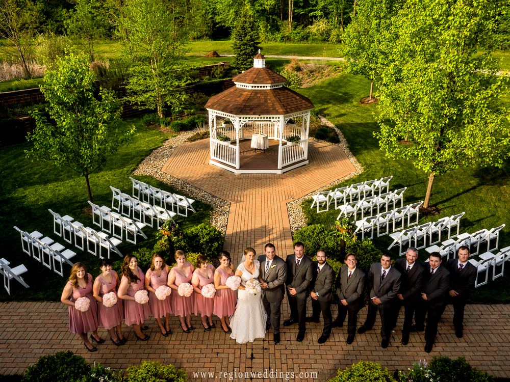 A photo of the wedding party shot from above at Trinity Hall in Chesterton.