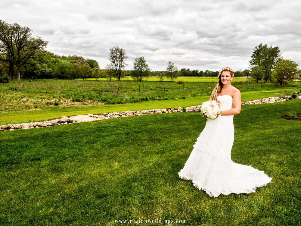 An Indiana bride amidst the miles of farmland off of I-65 in Fair Oaks, Indiana.