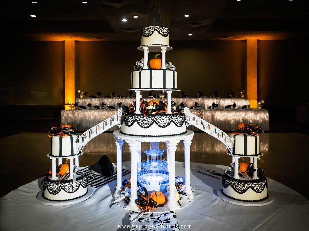 A multi tiered Fall decorated wedding cake at Villa Cesare Banquet Hall.