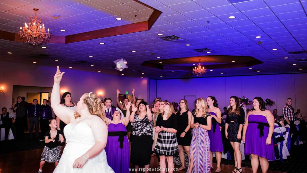 Bouquet toss at The Patrician Banquet Center.