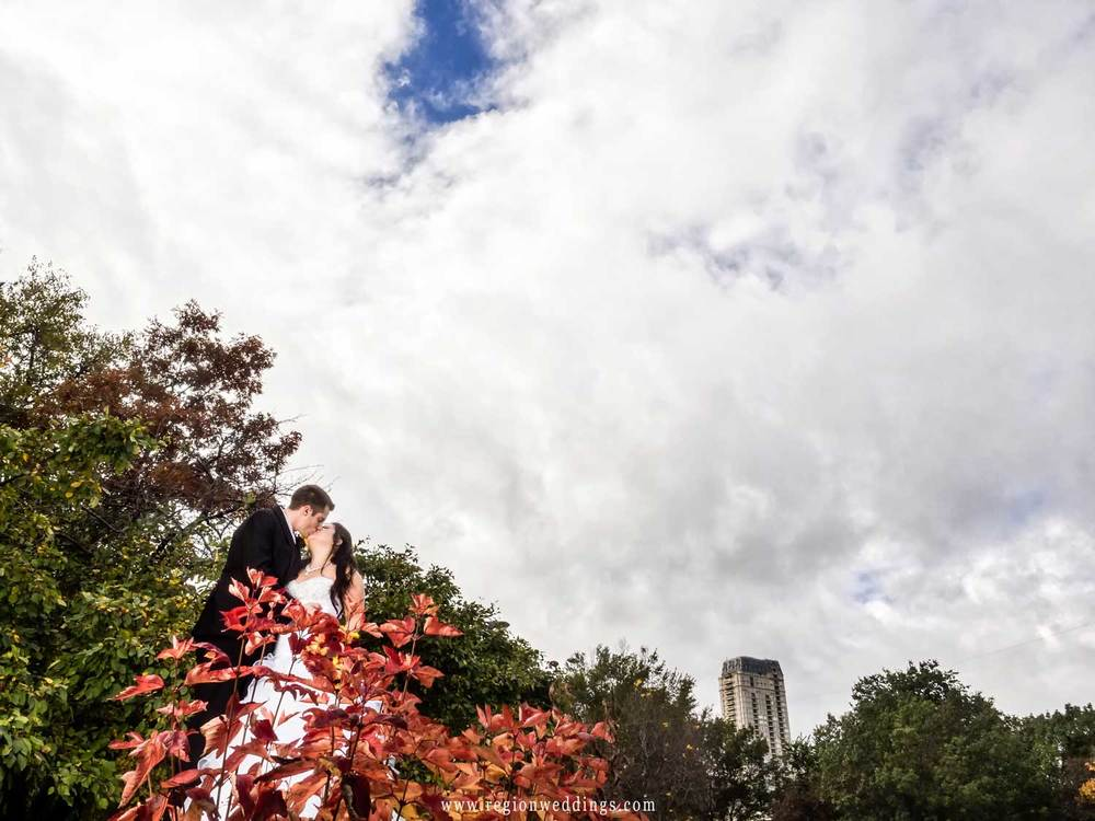 The bride and groom kiss at their Fall wedding in Chicago.