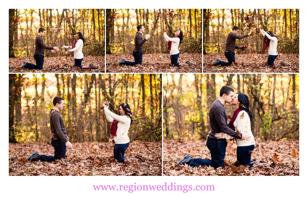 An engaged couple has a leaf fight for their photo session.