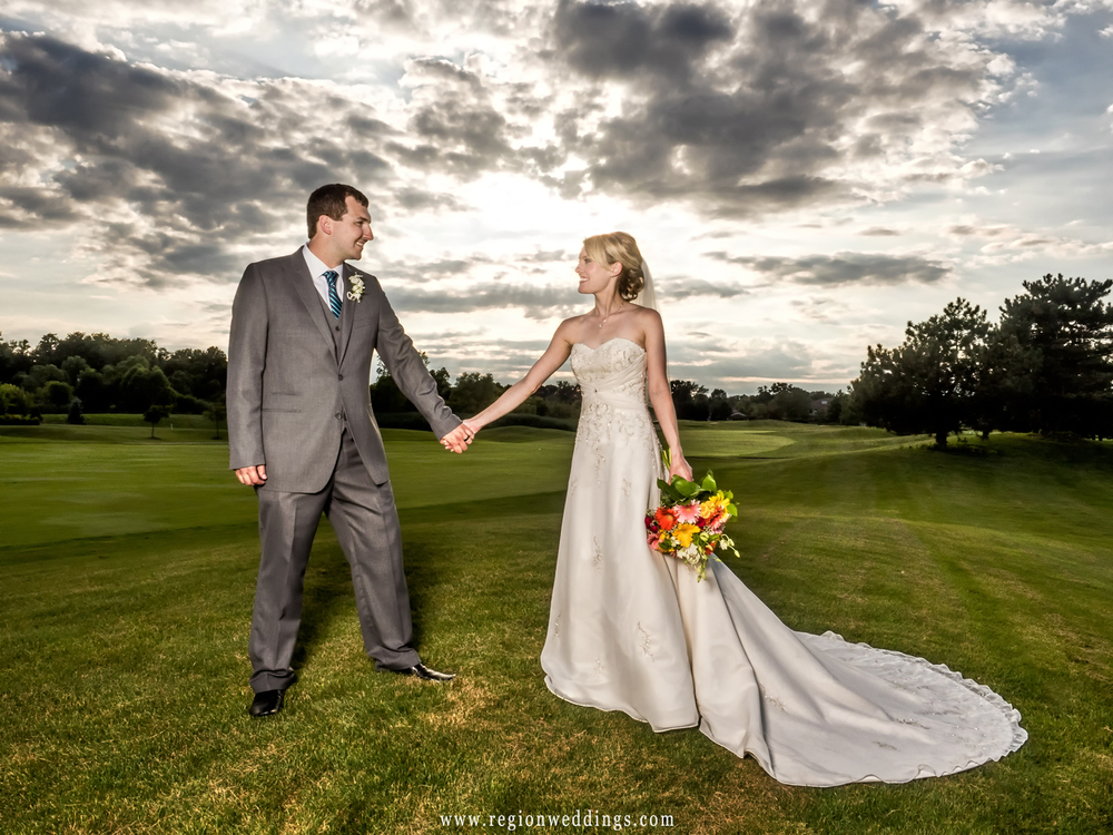 The bride and groom on the golf course at Sand Creek Country Club.