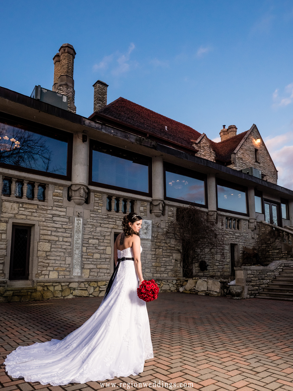 The bride shows off her dress on the patio terrace of Meyer's Castle.
