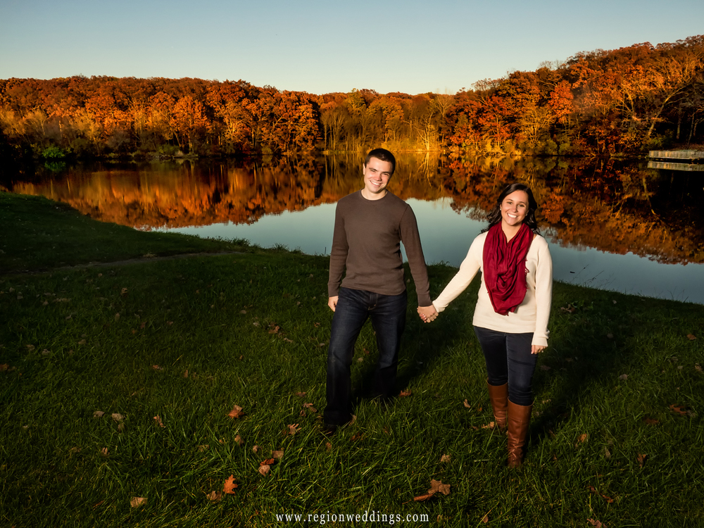 Trees reflect their Fall color onto Lemon Lake during an Autumn engagement session.