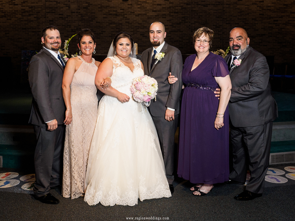 Family wedding photo at St. Maria Goretti Church.