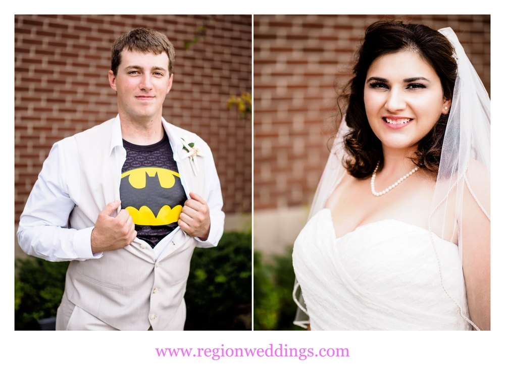 The groom shows off his Batman tee shirt as his bride looks on.