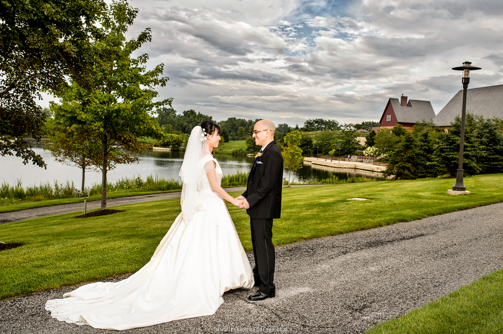 Storm clouds surround the bride and groom at Centennial Park in Munster, Indiana.