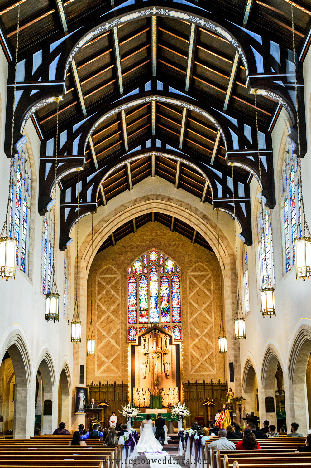 The spectacular architecture of St. Casimir Church during a wedding ceremony.