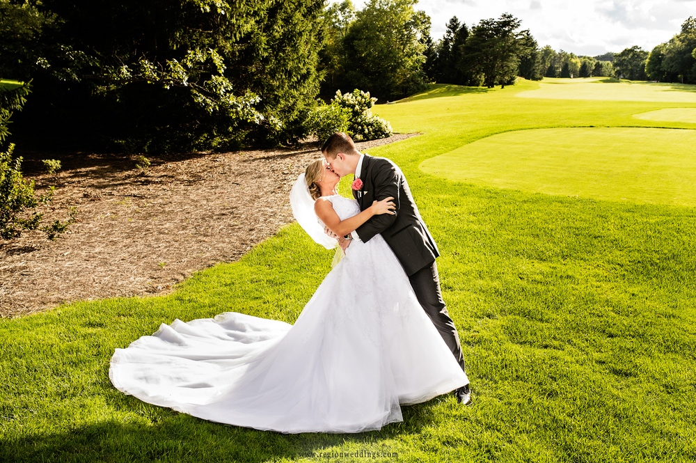 The groom dips his bride on the golf course at Sandy Pines in Demotte, Indiana.