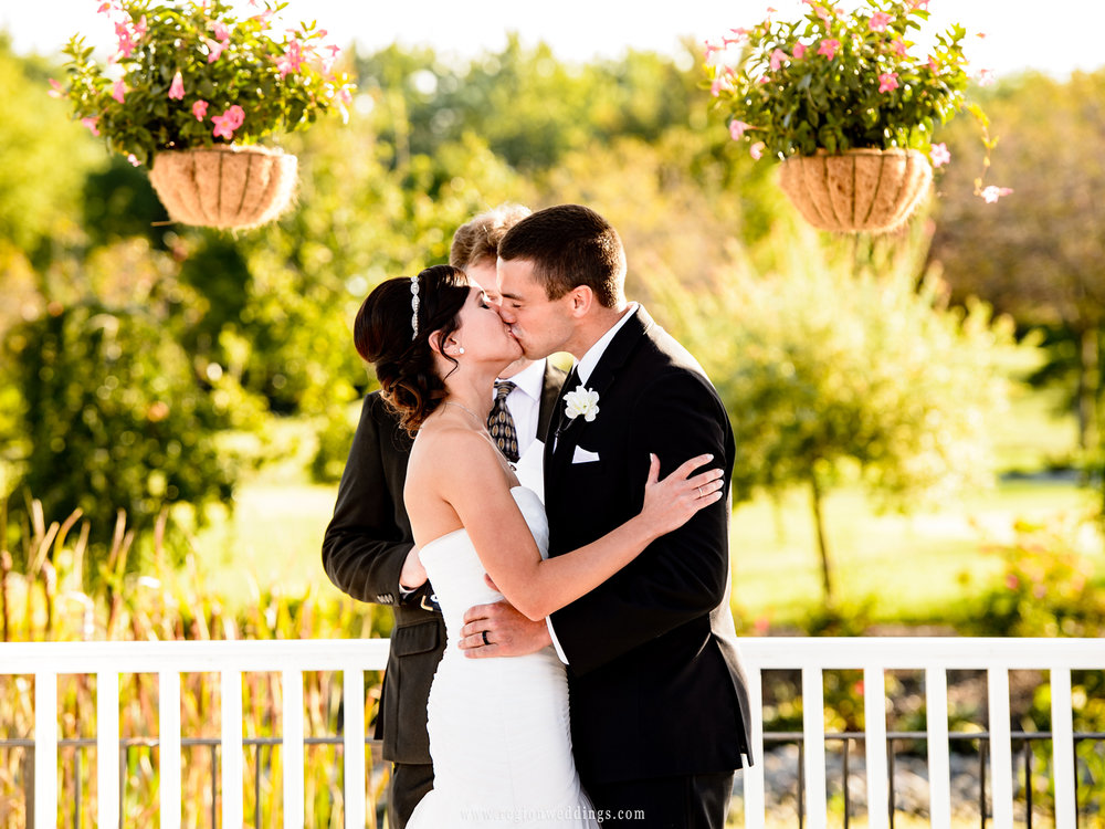 First kiss for the bride and groom at White Hawk Country Club in Crown Point, Indiana.