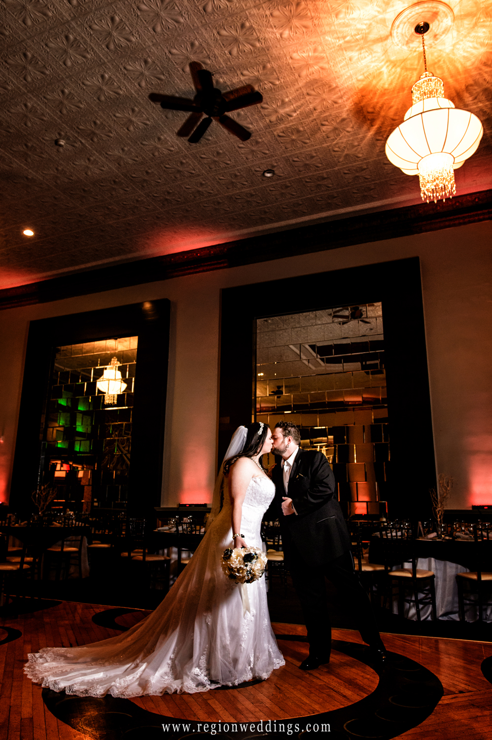 A kiss at the center of The Allure ballroom.