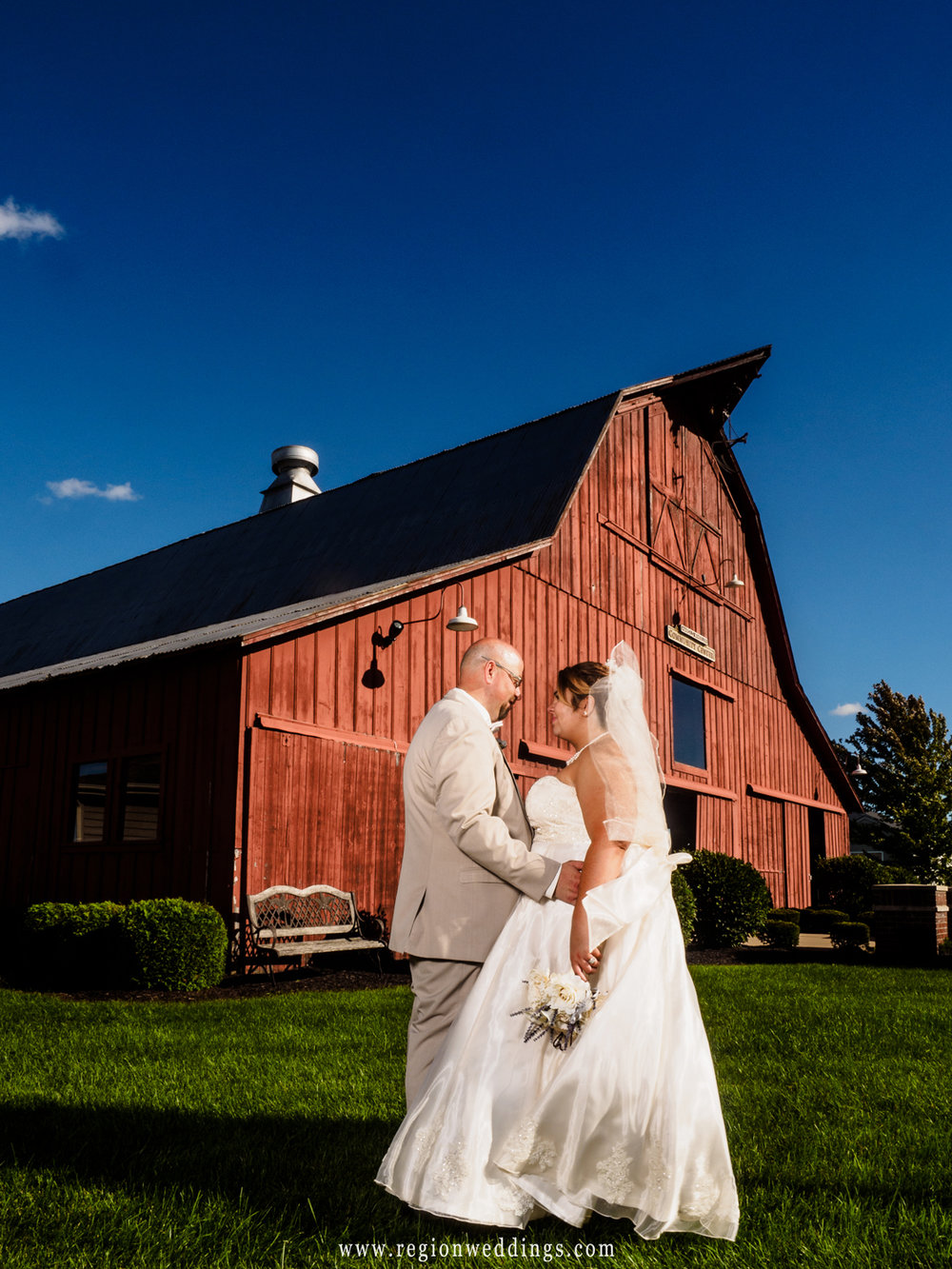 Bride and groom at their rustic barn wedding.