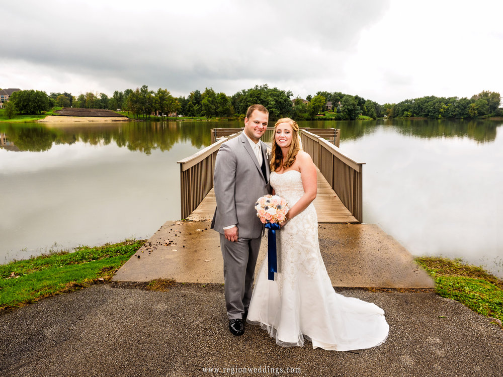 Bride and groom at the edge of the Lake Hills pier in St. John, Indiana.