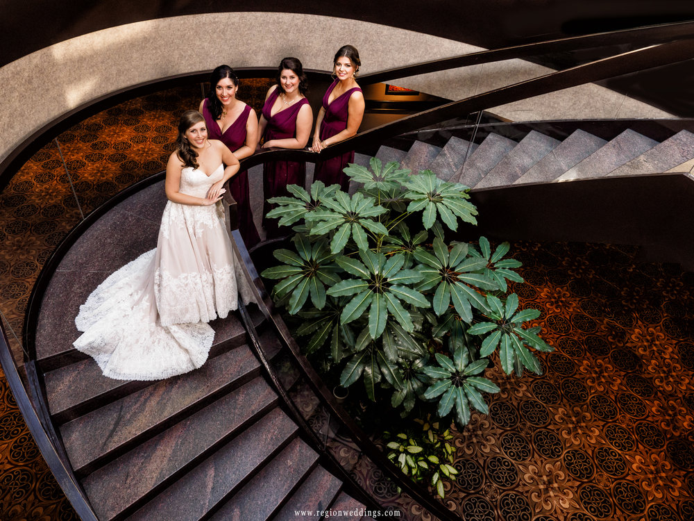 Bride and her bridesmaids on the staircase at The Center for Visual and Performing Arts.