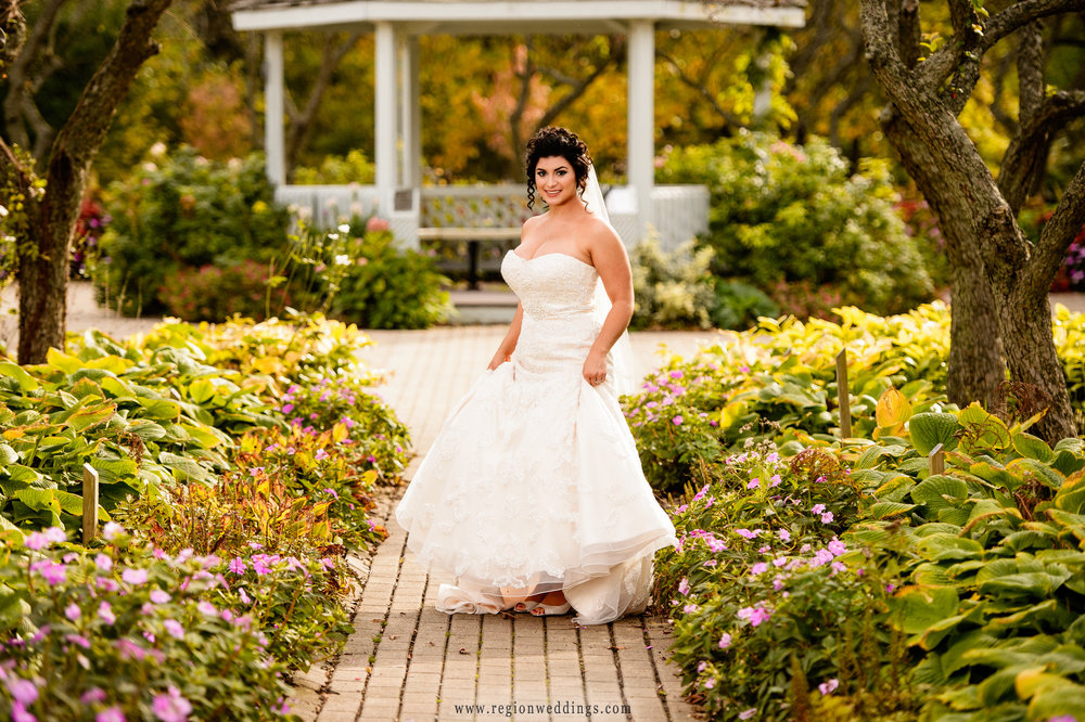 The bride takes a stroll through the pathway at the Ogden Gardens entrance.