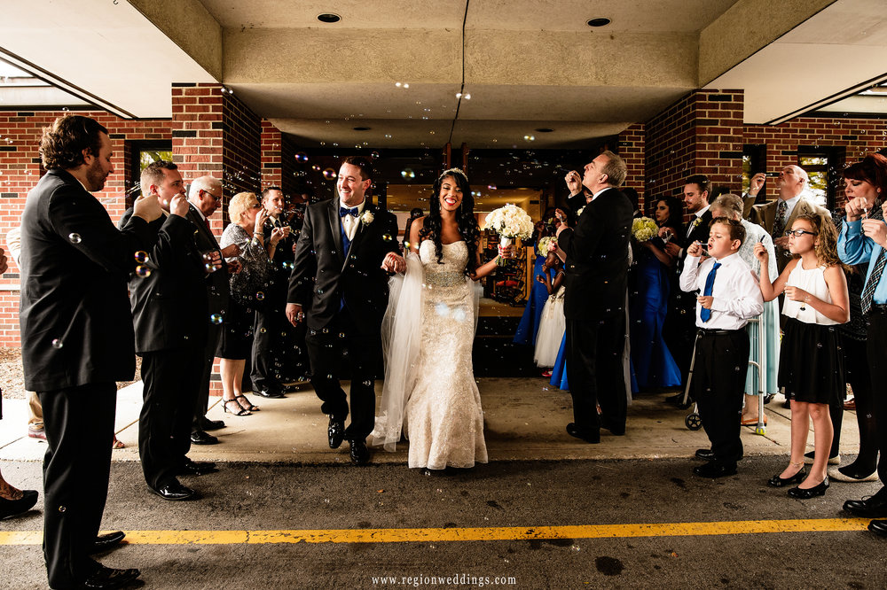 Bride and groom exit with bubbles at Westminster Presbyterian Church.