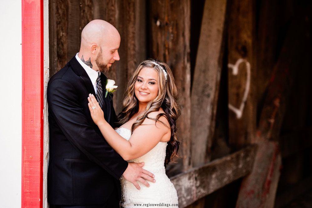 The bride and groom share a romantic moment in the old covered bridge at the Lake County Fairgrounds.