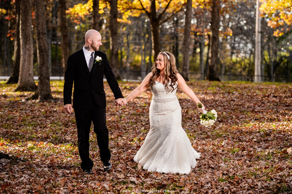 Autumn leaves crunch beneath the bride and groom's feet.