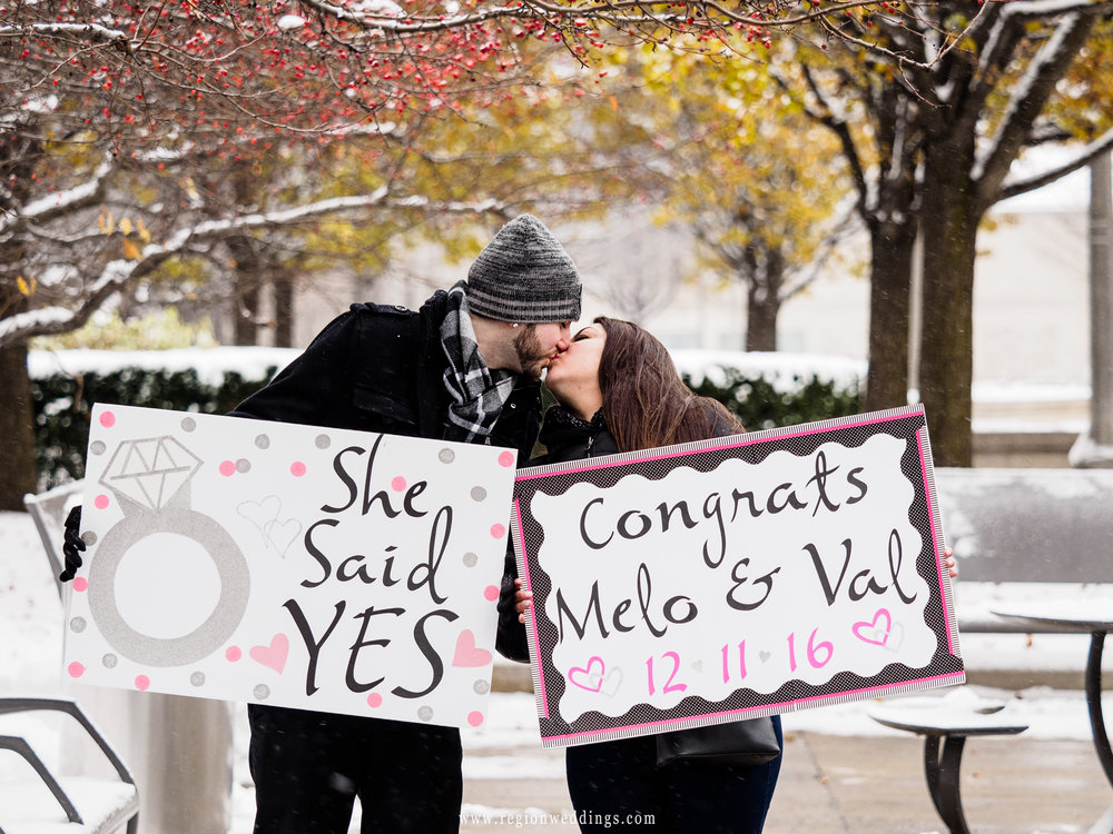 "Post proposal ""She Said Yes"" signs."