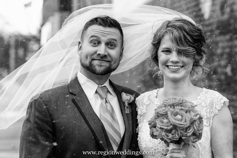 A sudden snowstorm breaks out during wedding photos in Crown Point, Indiana.