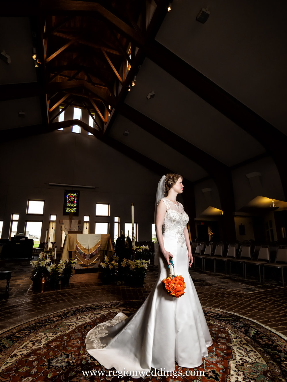 Bride alone at Holy Spirit Church in Crown Point, Indiana.