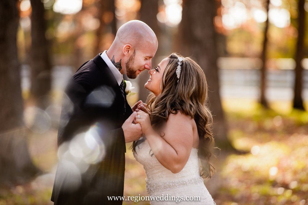 A romantic moment between bride and groom during a Fall wedding.