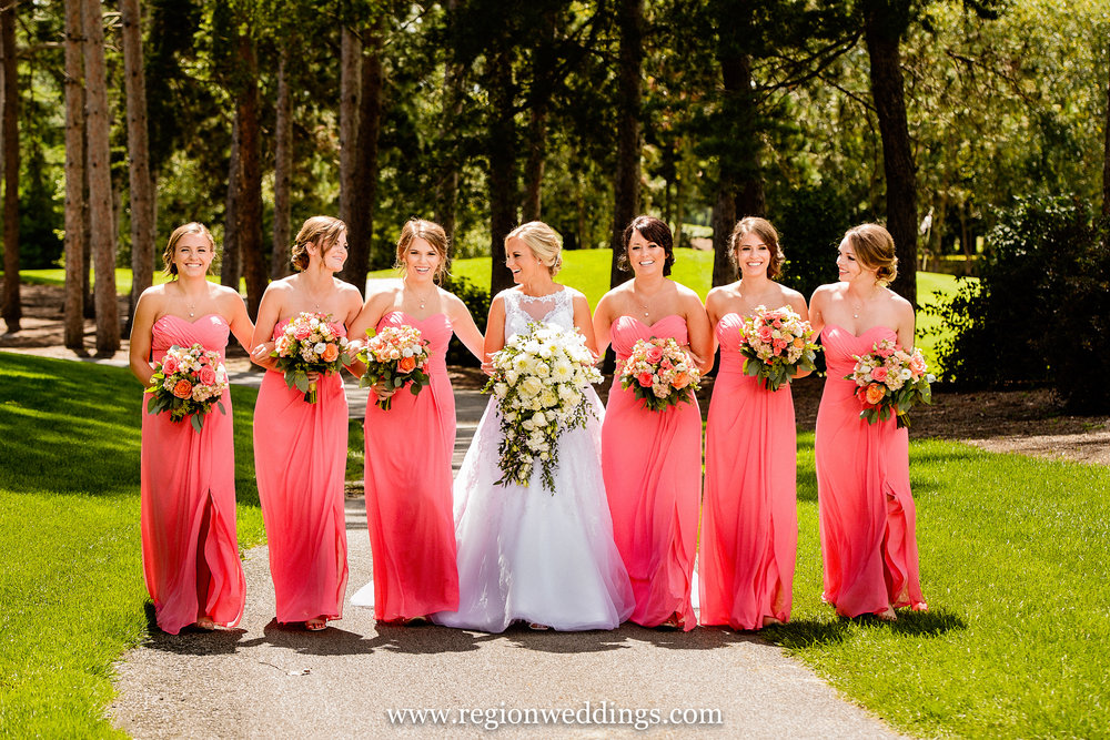 The bride and her bridesmaids take a walk at The Pavilion At Sandy Pines.